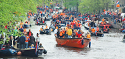 Queen's Day boats in a canal in Amsterdam, Holland. http://www.enjoy-europe.com/Starting-s.jpg