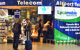 Pick up a mobile phone at Amsterdam's Schiphol Airport.