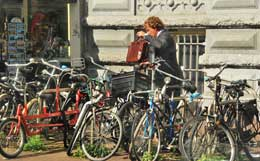 A young professional parks his bike in Amsterdam.