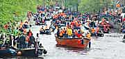 Queen's Day boats in a canal in Amsterdam, Holland. http://www.enjoy-europe.com/home/Starting-s-3.jpg