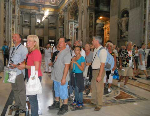 Tourists in line to enter a Rome museum.