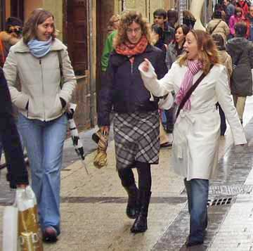 Three girls talking and walking in San Sebastian, January.