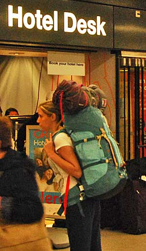 An overloaded backpacker at Amsterdam Schiphol Airport.