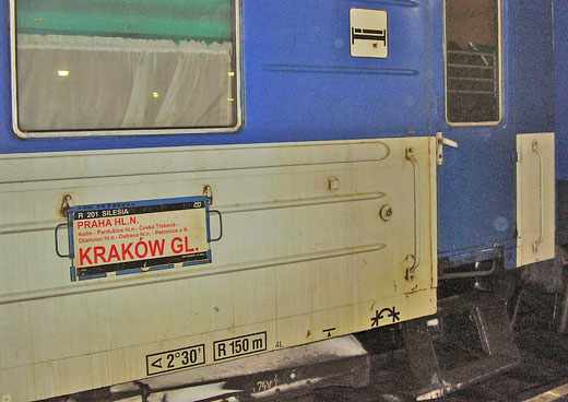 The icon of a bunk with a person in recline indicates a sleeping car in Prague, Czech Republic.
