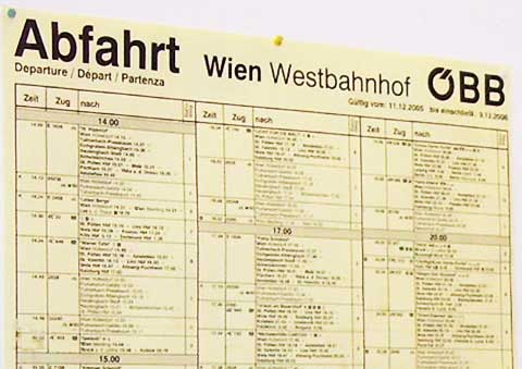 The train departure schedule is posted at the West Train Station in Vienna, Austria.