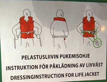 Life jacket instruction poster on the Silja Symphony sailing from Stockholm, Sweden to Helsinki, Finland.