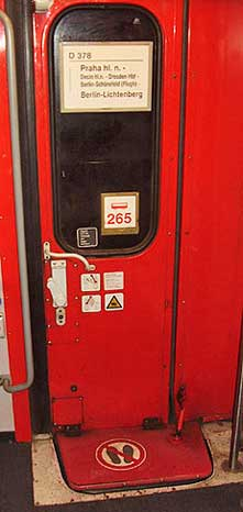 Typical train car door sign indicating the class of service, seat numbers, and smoking or not.