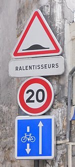 A 20 km/hr speed limit sign in Paris, France.