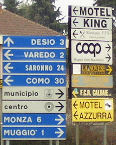 Direction signs in Nova Milanese, Italy. http://www.enjoy-europe.com/hte/chap18/Chap18images/P1080384ItalianRoadSigns.jpg