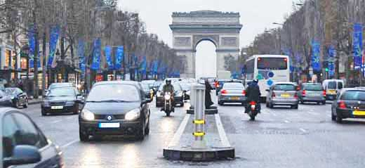 Driving on the Champs Elysees, Paris, France.