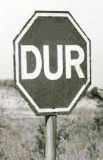 A stop sign in Turkey with the octagon and word Turkish Dur.