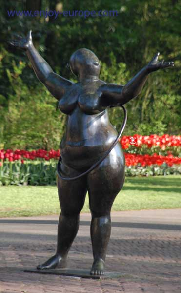 Statue of Fat Naked Lady with Hula Hoop
